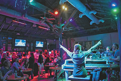 Sing along with Dueling Pianos