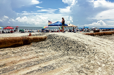 Island's beach restoration project nearing its last leg