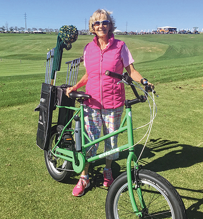 Dr. Jean Harris with a new Golf Bike. PHOTO BY SUE HOWARD