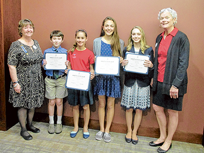 From left are Debi Bacon, Regent of Emily Geiger Chapter, Daughters of the American Revolution, with winners Oscar Conley, 5th grade, Ava Pratt, 6th grade, MaKenzy Sluiter, 7th grade, Claire Capell, 8th grade, and  Ann Piercy, DAR chair of the American Hi