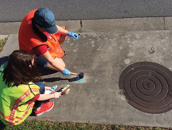 Volunteers sought to place reminder tiles on storm drains