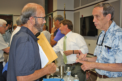 Collins Doughtie of Bluffton, left, listens to Paul Sommerville, chairman of Beaufort County Council, following the May 4 meeting of the council's development agreement subommittee. Tabor Vaux, chair of the subcommittee, center, greets other attendees.