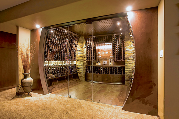 This curved wine cellar is both beautiful and functional. PHOTO COURTESY WINSLOW DESIGN STUDIO