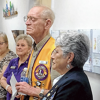 Artie Heape, center, at a recent Beaufort Lions Club meeting, with Pat Friday, Lions Club District Governor, S.C. District 32-B, to his left.