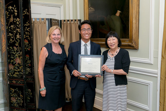 Matthew Choi receives his Certificate from Ambassadors Julia Chang Bloch and Laurie Fulton