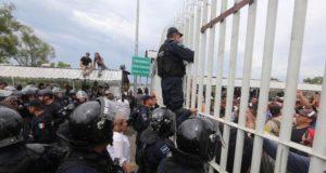 Frena PFP violencia en caravana migrante; hay lesionados
