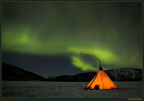 Glowing Tent Under Northern Lights