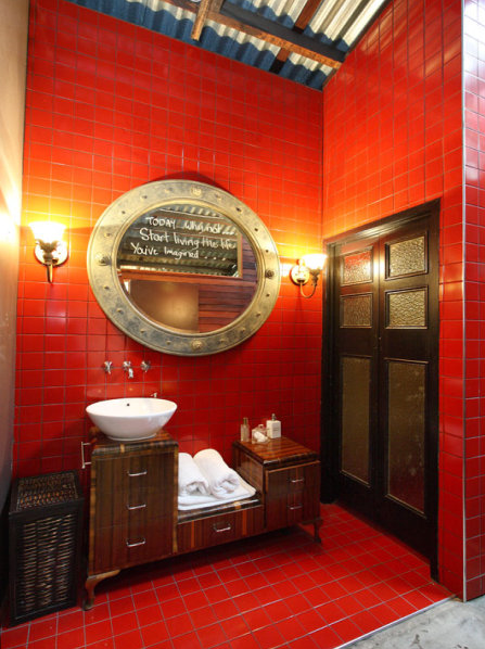 Red Tile Bathroom with a Cement Floor