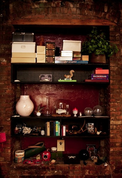 Cluttered Shelves Surrounded By Brick