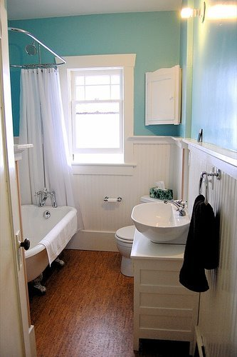 Turquiose Bathroom with White Wainscoting
