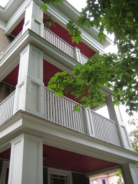 Giant White Columns and Red Porch Rooves