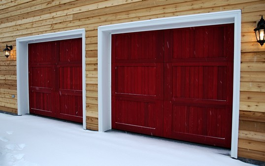 Red Garage Doors and a Pine Wall