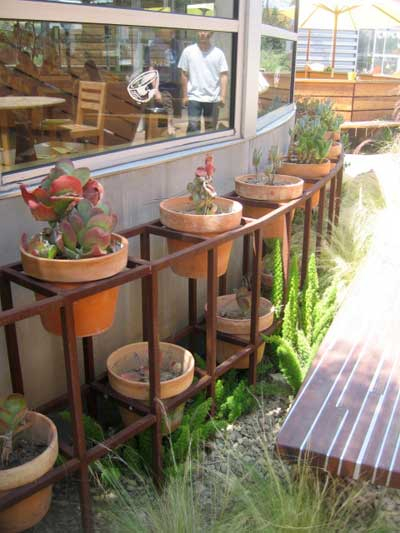 Rusty Steel Rack of Clay Pots