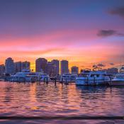 Beautiful sunset at the marina in Palm Beach Island overlooking the WPB skyline. HDR image created using Photomatix Pro and Topaz software.