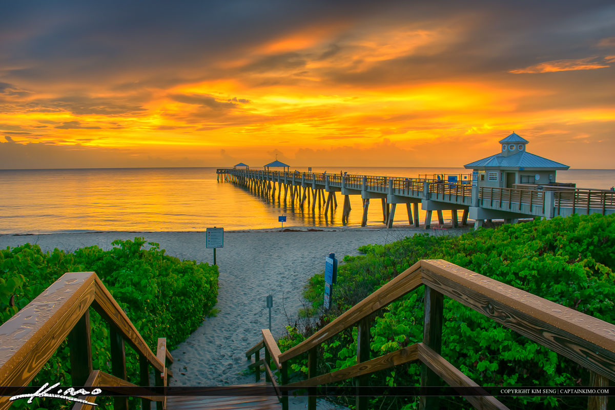 Warm sunrise colors at juno beach pier for Juno beach fishing pier