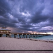 Dark storm cloud moving over the Juno Beach Fishing Pier along the beach in Palm Beach County. HDR image tone mapped in Photomatix Pro and Topaz software.