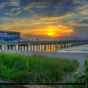 Amazing sunrise at the Lake Worth Pier along the beach in Palm Beach County Florida. HDR image created in Photomatix Pro and Topaz software.