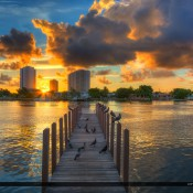 A beautiful morning at the docks in Phil Foster Park during sunrise over Singer Island, Florida. HDR image created using Photomatix Pro HDR software and Topaz plugin.