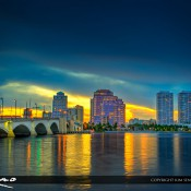 Sun peaking through the clouds behind the West Palm Beach Skyline in Palm Beach County Florida. Three exposure HDR image created using Photomatix Pro and Topaz software.