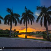Vibrant sunset over Palm Beach Gardens at a local neighborhood lake road with Royal Palm Trees. HDR image tone mapped in Photomatix Pro and Topaz software.
