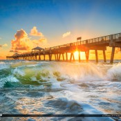 Breaking wave at the Juno Beach Pier during sunrise over Atlantic Ocean in Palm Beach County, Florida. HDR image created in Photomatix Pro and Topaz software.