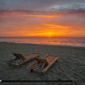 Pair of beach chairs in South Florida waiting for someone to sit and watch the sunrise. HDR image created in Aurora HDR by Macphun.