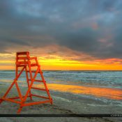 Beautiful colors during sunrise at Jacksonville Beach by the pier with red lifegaurd tower. HDR image created in Photomatix Pro HDR software.