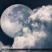 Large moon setting behind some clouds. Composite from two different images. Created using Photoshop and treated with Aurora.