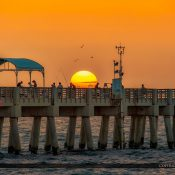 Fishing on the Lake Worth Pier during sunrise over the Atlantic Coast in Palm Beach County Florida. Image tone mapped using Aurora HDR software.