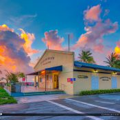 Sunrise at the Pompano Beach Pier with purple clouds over the entrance. HDR photography image created using Aurora HDR software by Macphun.