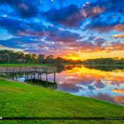 Beautiful colors over the Acreage in Loxahatchee Florida during sunset along a small lake. HDR image created using Aurora HDR software by Macphun.