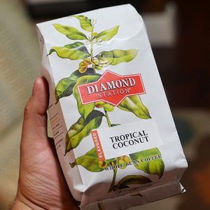 Holding Diamond Station coffee bag.