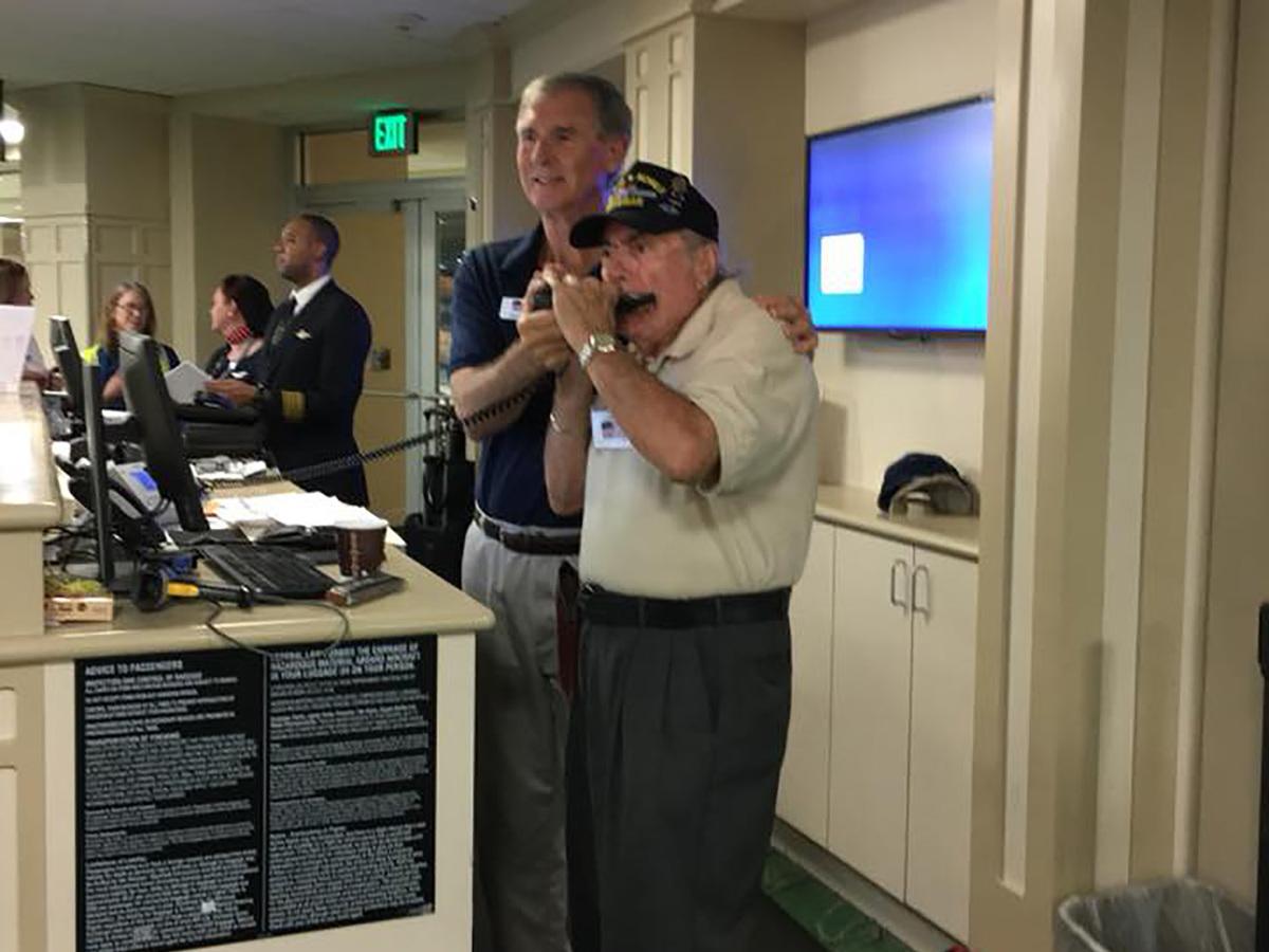Veteran playing harmonica honor flight 31 sep 26  2017