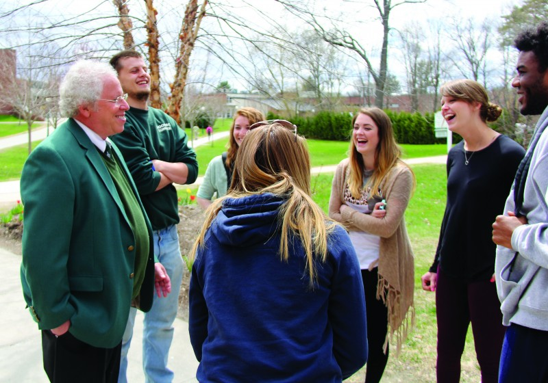 President Wolk talking with students