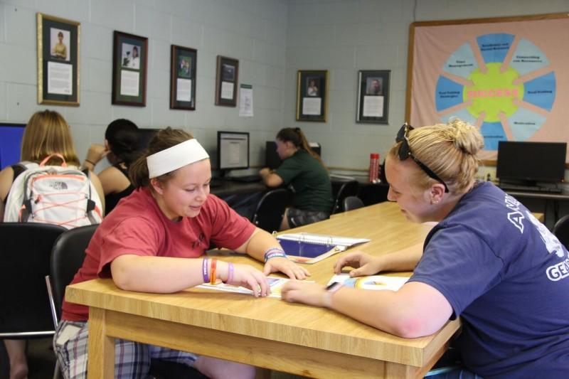 Peer tutor with student