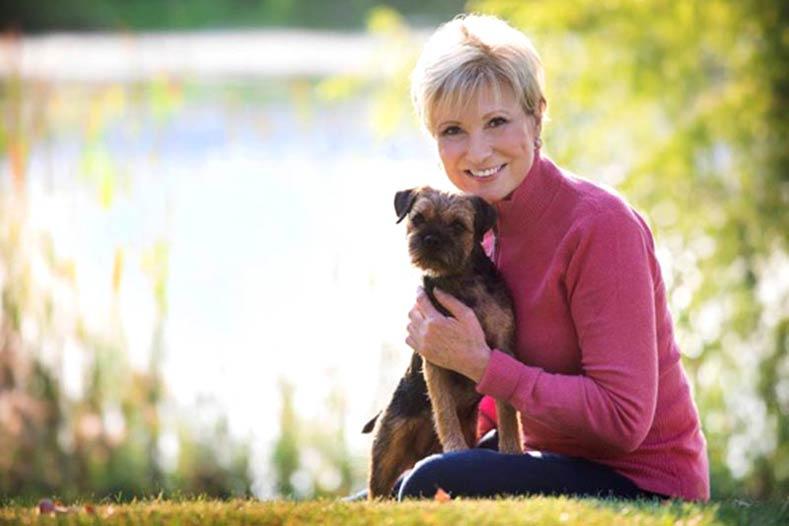 Karen Fitzpatrick Breeder of Merit with her Border Terrier