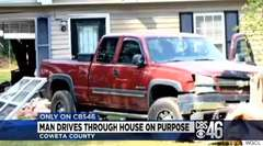 Man Drives Through Own House