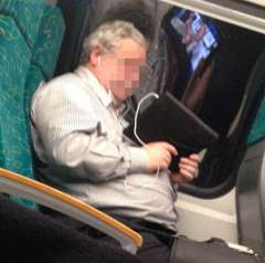Guy Watching Porn on Train