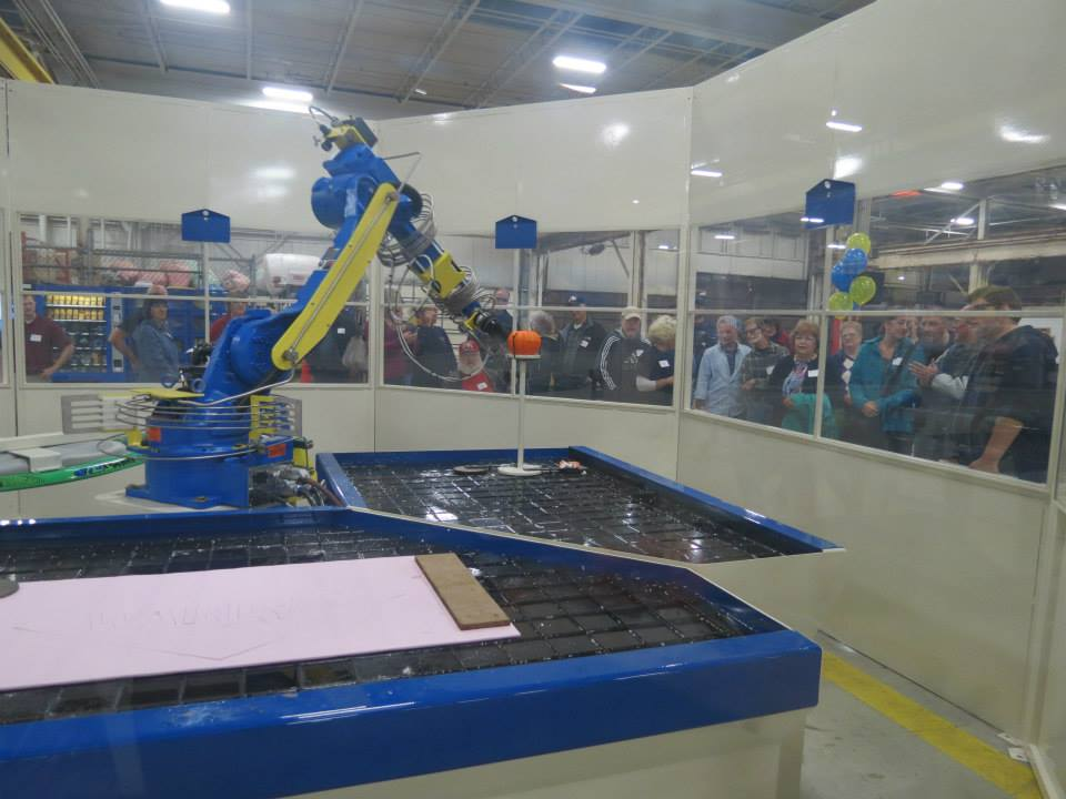 The waterjet robot demonstrates cutting during the family and friends event