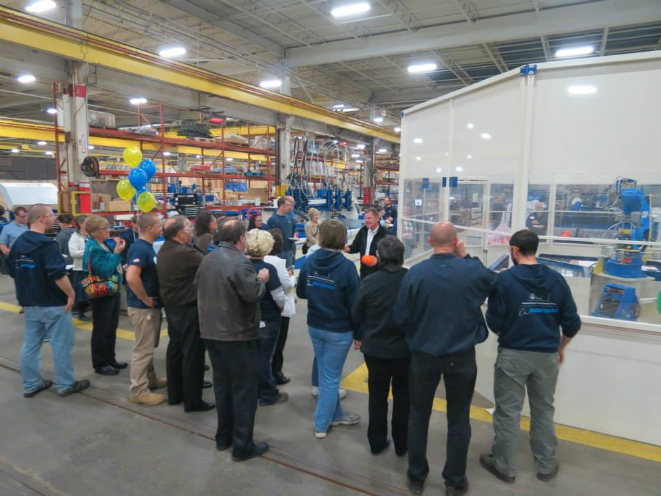 WARDJet friends and family get an explanation of the waterjet robot from Yaskawa Motoman rep Harald