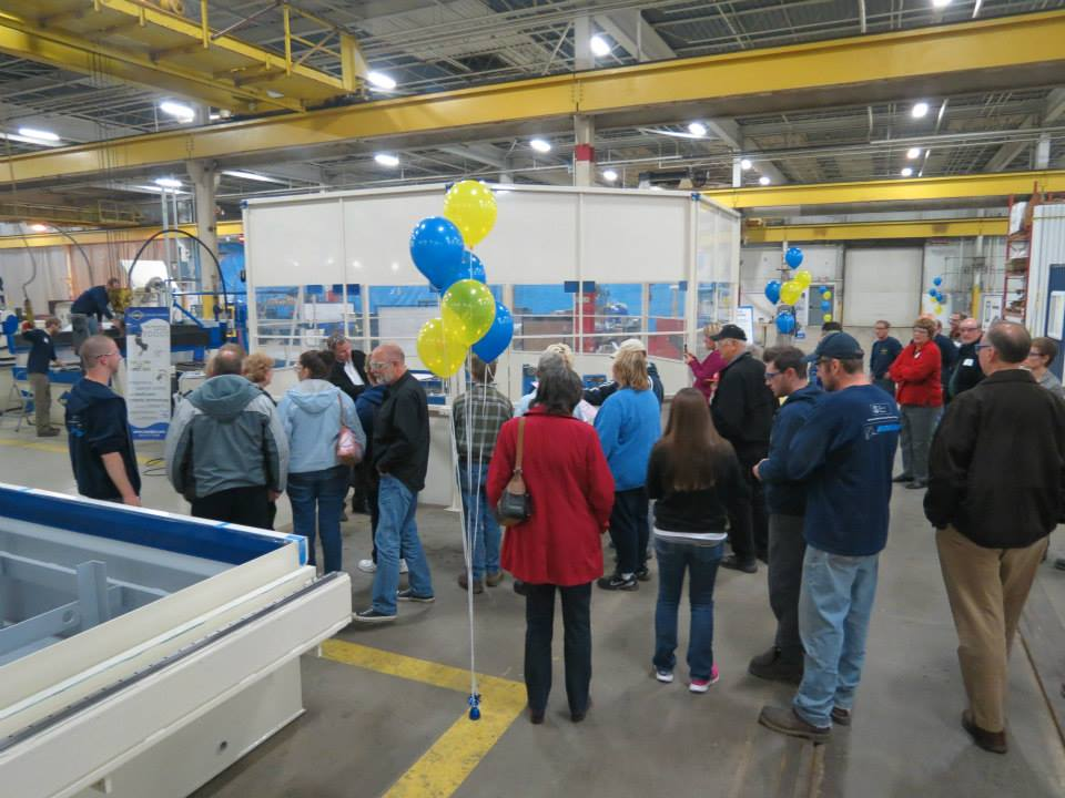Family and friends gather to watch the waterjet robot in action
