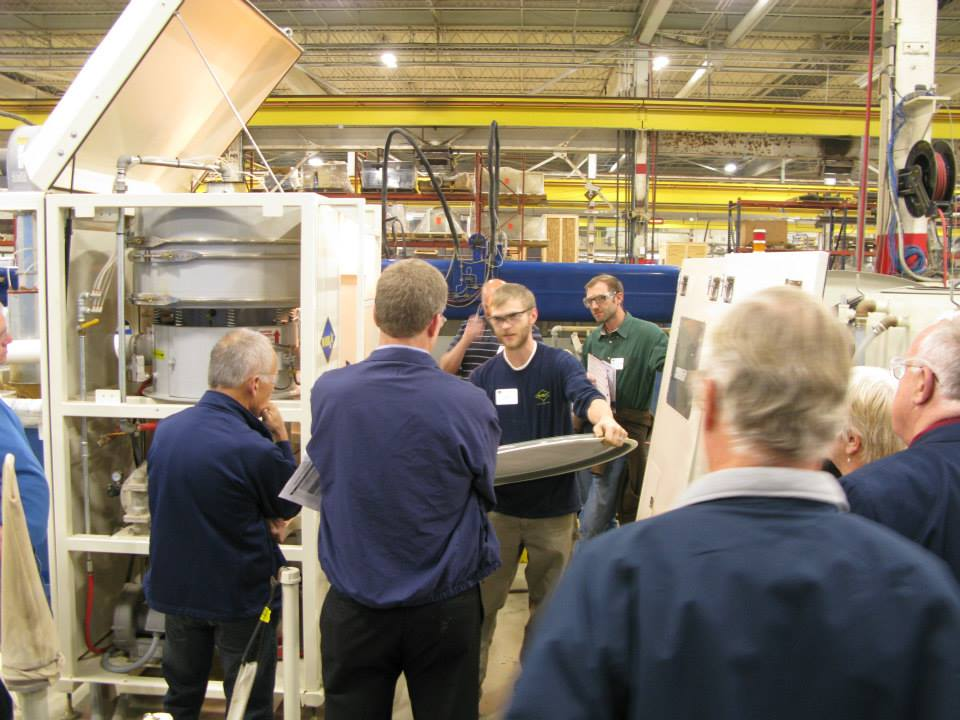 Tim shows open house guests the top screen that sorts abrasive mesh sizes in the WARD Pro