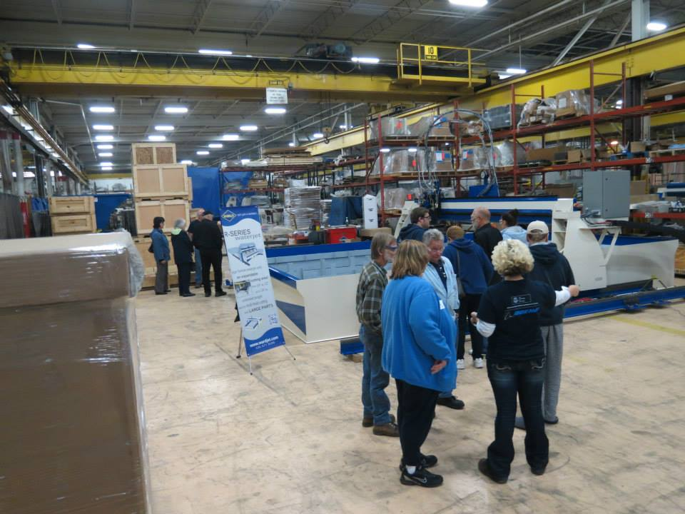 Family and friends of WARDJet employees mingle after day one of the open house