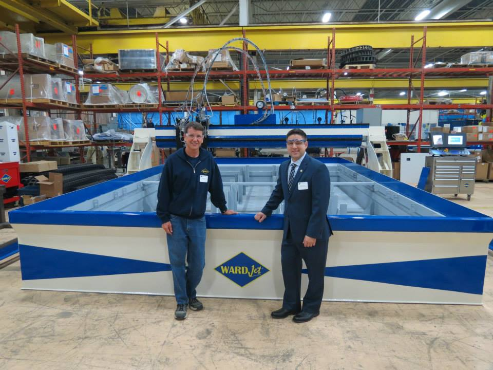 Richard Ward and Rep. Anthony DeVitis pose by the R-Series waterjet tank during the friends and family event