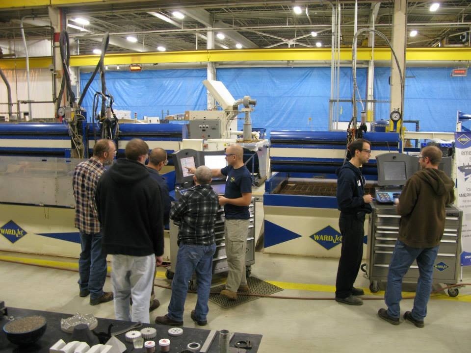 WARDJet team members discuss waterjets with open house visitors