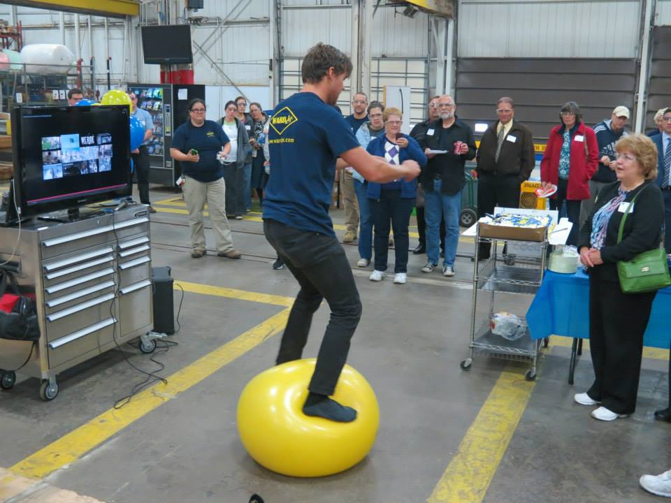 Pro snowboarder Steve MacCutcheon balances on an exercise ball to show how he strength trains for the Olympics