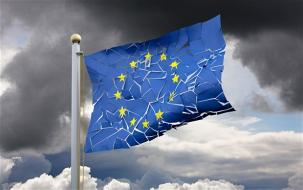 A eurozone flag flag that appears cracked with a stormy background