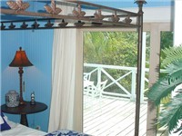 Downstairs bedrooms both open onto deck for easy access to beach and dock.