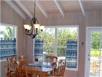 Your choice of dining at Hope Town Hideaways is inside dining room, breakfast bar or teak table on your veranda overlooking the water.