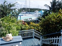 The private deck on this Abaco rental house leads to the large pool and private harbour beach as well as exotic gardens. Enjoy your own place in the sun.